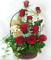 9 Red roses and A bear